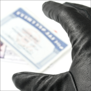 Gloved hand stealing social security card